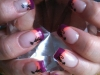 halloween-nails-with-purple-and-orange-with-black