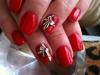 red-nails-with-gift-accent-finger